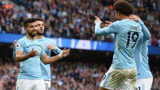 Manchester City's Argentinian striker Sergio Aguero (L) celebrates after scoring with Manchester City's German midfielder Leroy Sane during the English Premier League football match between Manchester City and Crystal Palace at the Etihad Stadium in Manchester, north west England, on September 23, 2017. / AFP PHOTO / Oli SCARFF / RESTRICTED TO EDITORIAL USE. No use with unauthorized audio, video, data, fixture lists, club/league logos or 'live' services. Online in-match use limited to 75 images, no video emulation. No use in betting, games or single club/league/player publications.  /
