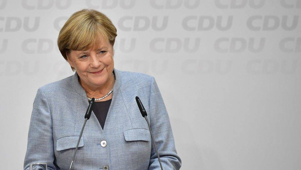 German Chancellor Angela Merkel listens to a question during a press conference at the headquarters of the Christian Democratic Union (CDU) party in Berlin on September 25, 2017, one day after general elections. Merkel woke up to a fourth term but now faces the double headache of an emboldened hard-right opposition party and thorny coalition talks ahead. / AFP PHOTO / Tobias SCHWARZ