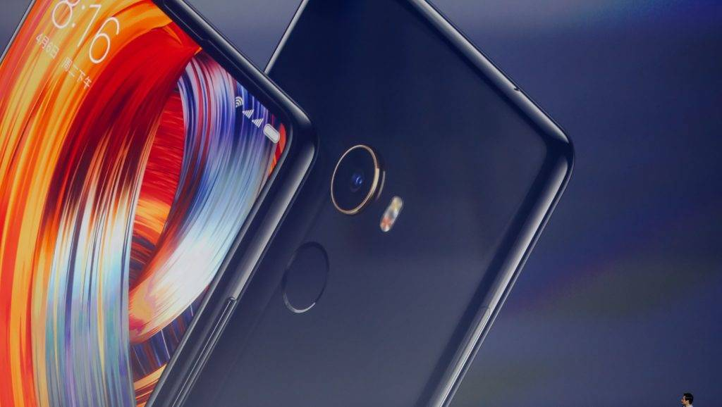 """Lei Jun, Chairman and CEO of Xiaomi Technology and Chairman of Kingsoft Corp., introduces Xiaomi's Mi Mix 2 smartphone at the launch event in Beijing, China, 11 September 2017.  Xiaomi, which has been dubbed """"China's Apple"""", has sent out invites for a special event on September 11 in Beijing. Chinese company unveiled their second gen MIX along with a new Mi Note 3 flagship model. The company launched the Mi Mix 2 one day before the iPhone 8 announcement – a premium, flagship smartphone that's anticipated to come with an edge-to-edge display. A new laptop tomorrow, named Mi Notebook Pro, also unveiled. This new Mi Notebook Pro will pack a larger 15.6 inch display, with 20V/2.25A or 20V/3.25A power adapter, that will provide a maximum power supply of 45W or 65W respectively and 4G mobile network compatibility."""