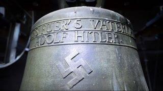 A bronze church bell featuring a swastika and the slogan 'Everything for the Fatherland - Adolf Hitler' in the tower of St. Jacob's Church in Herxheim am Berg, Germany, 19 May 2017. Photo: Uwe Anspach/dpa