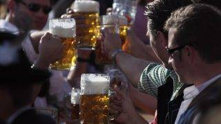 MUNICH, GERMANY - OCTOBER 03:  Revellers cheer with beer mugs during the last day of Oktoberfest beer festival on October 2, 2011 in Munich, Germany.  (Photo by Johannes Simon/Getty Images)