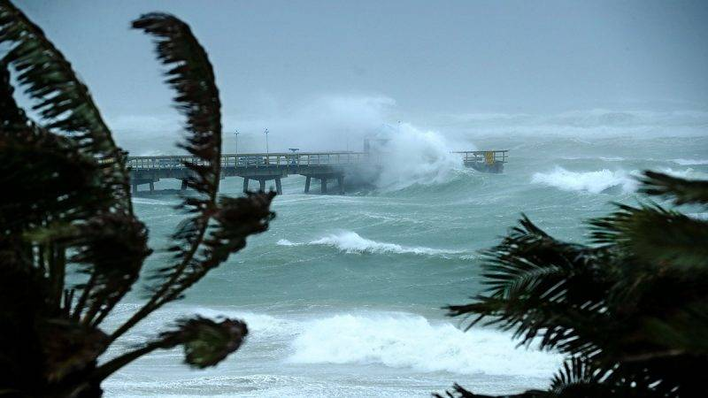 FORT LAUDERDALE, FL - SEPTEMBER 10:  Large waves produced by Hurricane Irma crash into the end of Anglins Fishing Pier September 10, 2017 in Fort Lauderdale, Florida. The category 4 hurricane made landfall in the United States in the Florida Keys at 9:10 a.m. after raking across the north coast of Cuba.  (Photo by Chip Somodevilla/Getty Images)