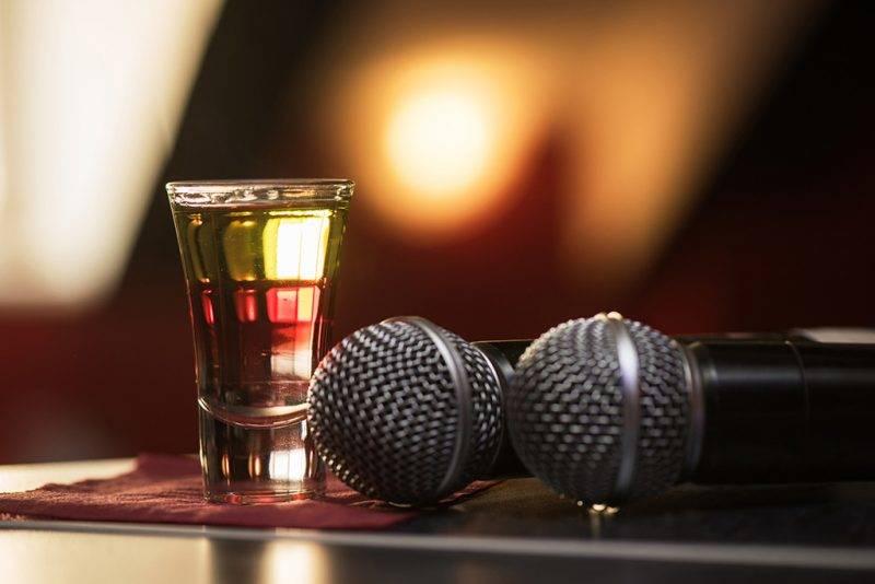 Closeup photo in a bar where barmen burning drink shot