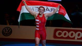 Hungary's Marianna Sastin celebrates her victory over Bulgaria's Taybe Mustafa Yusein (not pictured) after the women's free style 59 kg category final of the FILA World Wrestling Championships in Budapest on September 19, 2013. Sastin won the gold medal.  AFP PHOTO / ATTILA KISBENEDEK / AFP PHOTO / ATTILA KISBENEDEK