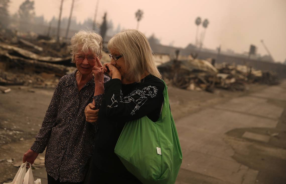 SANTA ROSA, CA - OCTOBER 09:  Residents walk through the fire damaged Journey's End Mobile Home Park on October 9, 2017 in Santa Rosa, California. Ten people have died in wildfires that have burned tens of thousands of acres and destroyed over 1,500 homes and businesses in several Northen California counties.  (Photo by Justin Sullivan/Getty Images)