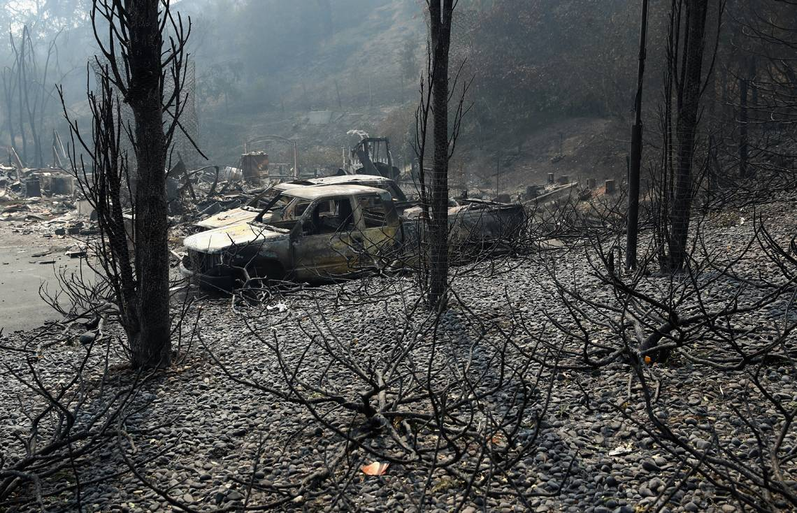 NAPA, CA - OCTOBER 10:  A view of the remains of homes that were destroyed by the Atlas Fire on October 10, 2017 in Napa, California.  Fifteen people have died in wildfires that have burned tens of thousands of acres and destroyed over 2,000 homes and businesses in several Northen California counties.  (Photo by Ezra Shaw/Getty Images)