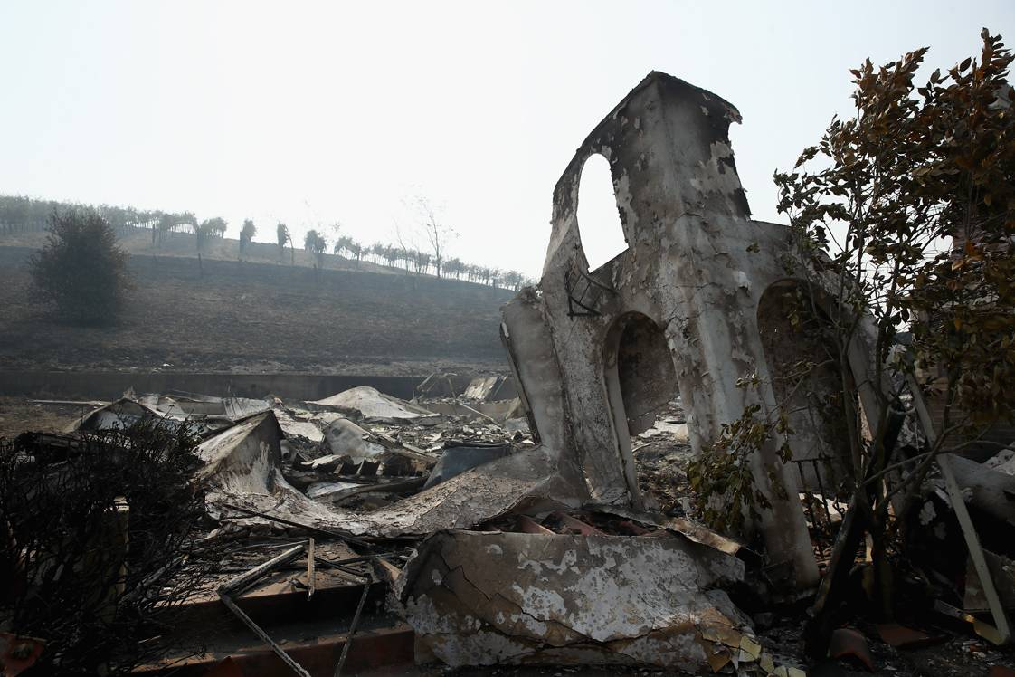 NAPA, CA - OCTOBER 10:  A view of the remains of the buildings at Stornetta Dairy that were destroyed by the Atlas Fire on October 10, 2017 in Napa, California.  Fifteen people have died in wildfires that have burned tens of thousands of acres and destroyed over 2,000 homes and businesses in several Northen California counties.  (Photo by Ezra Shaw/Getty Images)