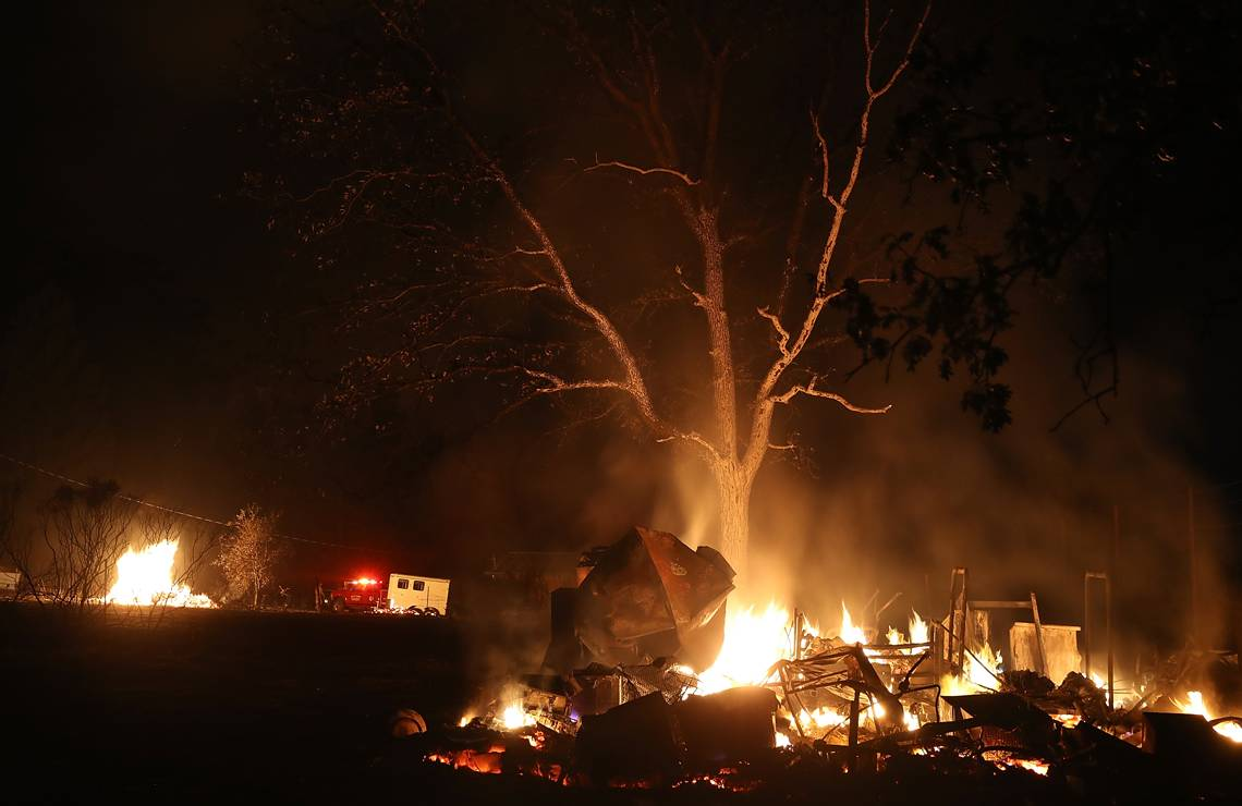 KENWOOD, CA - OCTOBER 10:  A pile of furniture burns during the Nuns Fire on October 10, 2017 in Kenwood, California. Fifteen people have died in wildfires that have burned tens of thousands of acres and destroyed over 2,000 homes and businesses in several Northen California counties.  (Photo by Justin Sullivan/Getty Images)