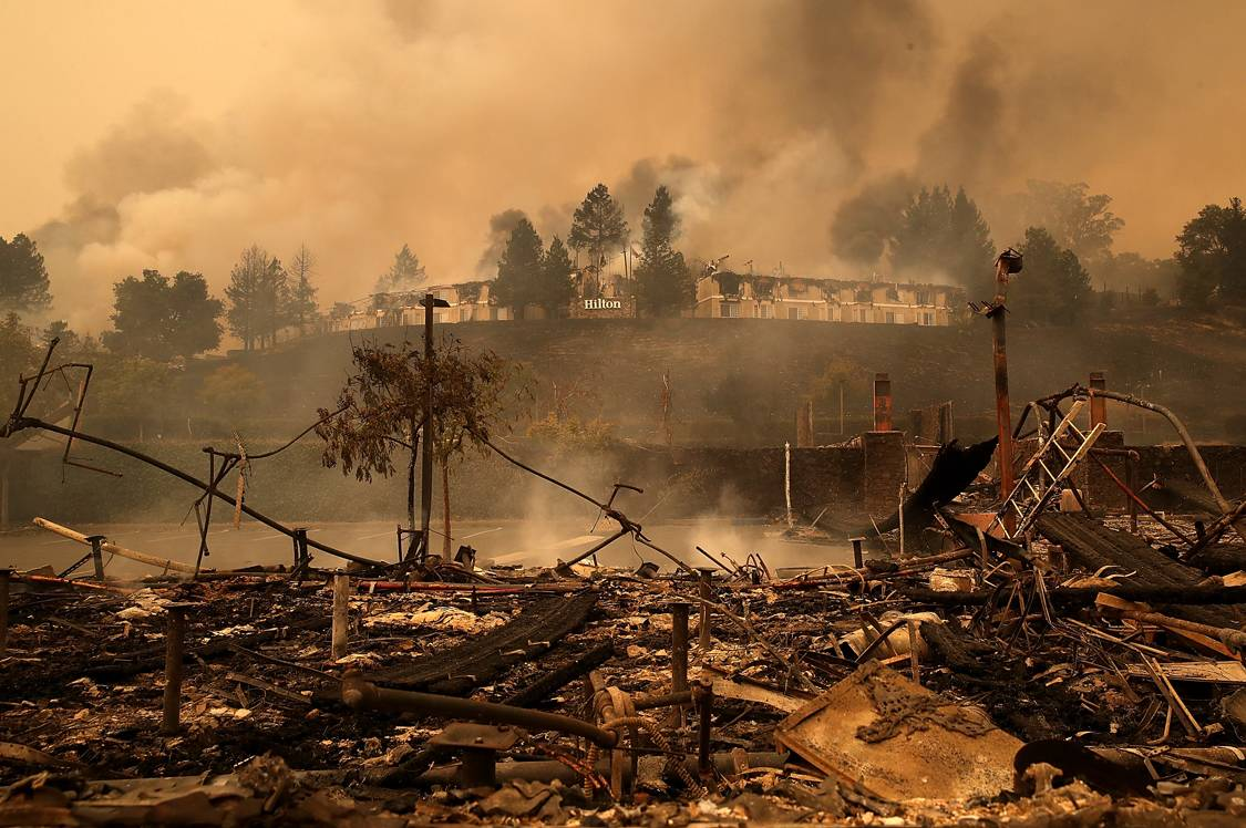 SANTA ROSA, CA - OCTOBER 09:  Smoke continues to rise from the Hilton Sonoma Wine Country on October 9, 2017 in Santa Rosa, California. Ten people have died in wildfires that have burned tens of thousands of acres and destroyed over 1,500 homes and businesses in several Northen California counties.  (Photo by Justin Sullivan/Getty Images)