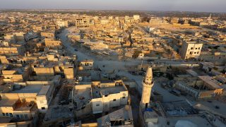 An aerial view shows destruction in al-Bab on March 29, 2017 a month after Turkish-backed rebels recaptured the northern Syrian town from Islamic State (IS) group fighters. Turkey on March 29, 2017 announced its military campaign inside northern Syria was over, without specifying whether it will pull its troops out from the neighbouring country / AFP PHOTO / Zein Al RIFAI