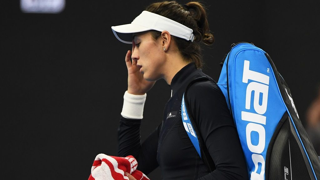 Garbine Muguruza of Spain walks off the court after retiring from her women's singles match against Barbora Strycova of the Czech Republic at the China Open tennis tournament in Beijing on October 2, 2017. / AFP PHOTO / GREG BAKER
