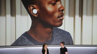 Isabelle Olsson, lead designer for home hardware for Google, Inc., and Juston Payne, Product Manager for Google Clips at Google Inc., demonstrate two-way translation using Google Pixel Buds and the Google Pixel 2 smartphone at a product launch event on October 4, 2017 at the SFJAZZ Center in San Francisco, California. Google unveiled newly designed versions of its Pixel smartphone, the highlight of a refreshed line of devices which are part of the tech giant's efforts to boost its presence against hardware rivals. / AFP PHOTO / Elijah Nouvelage