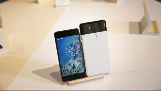The new Pixel 2 and Pixel 2 XL smartphones are seen at a product launch event on October 4, 2017 at the SFJAZZ Center in San Francisco, California. Google unveiled newly designed versions of its Pixel smartphone, the highlight of a refreshed line of devices which are part of the tech giant's efforts to boost its presence against hardware rivals. / AFP PHOTO / Elijah Nouvelage