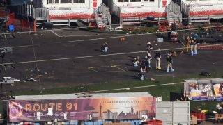 """FBI investigators continue work at Las Vegas Village in Las Vegas, Nevada on October 4, 2017, the site of the worst mass murder in modern US history.   Mass killer Stephen Paddock used semi-automatic weapons which he modified with """"bump-fire stock"""" to make them fire at the same speed as a fully automatic weapon when he killed 58 people and injured over 500 in the worst mass shooting in modern American history on October 1, 2017 at a country music festival in Las Vegas. / AFP PHOTO / Robyn Beck"""