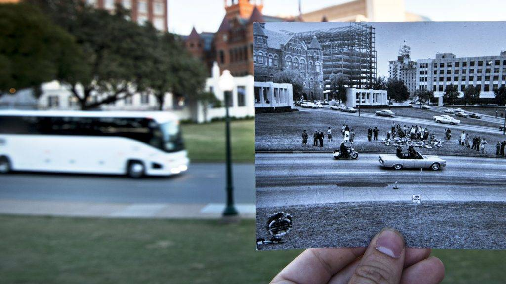 (FILES) This file photo taken on November 8, 2013 shows a historic photo of post JFK assassination Dealey Plazza (Dallas Police Department, Dallas Municipal Archives, City of Dallas, Texas) displayed near its original location in Dallas, Texas. A trove of secret documents about the assassination of US president John F. Kennedy is to be released on October 26, 2017 but scholars say they are unlikely to contain any bombshell revelations -- or put to rest the rampant conspiracy theories. The Warren Commission which investigated the November 22, 1963 shooting of the charismatic 46-year-old president determined that it was carried out by a former Marine sharpshooter, Lee Harvey Oswald, acting alone.   / AFP PHOTO / BRENDAN SMIALOWSKI
