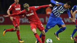 Cologne's German defender Jannes Horn and Berlin's German forward Davie Selke (R) vie for the ball during the German Cup (DFB Pokal) football match Hertha Berlin v 1 FC Cologne at the Olympic stadium in Berlin on October 25, 2017.  / AFP PHOTO / John MAC DOUGALL / RESTRICTIONS: ACCORDING TO DFB RULES IMAGE SEQUENCES TO SIMULATE VIDEO IS NOT ALLOWED DURING MATCH TIME. MOBILE (MMS) USE IS NOT ALLOWED DURING AND FOR FURTHER TWO HOURS AFTER THE MATCH. == RESTRICTED TO EDITORIAL USE == FOR MORE INFORMATION CONTACT DFB DIRECTLY AT +49 69 67880   /