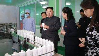 """This undated picture released from North Korea's official Korean Central News Agency (KCNA) on October 29, 2017 shows North Korean leader Kim Jong-Un (C) inspecting the Pyongyang Cosmetics Factory, as his wife Ri Sol-Ju (R) looks on. / AFP PHOTO / KCNA VIA KNS / STR / South Korea OUT / REPUBLIC OF KOREA OUT   ---EDITORS NOTE--- RESTRICTED TO EDITORIAL USE - MANDATORY CREDIT """"AFP PHOTO/KCNA VIA KNS"""" - NO MARKETING NO ADVERTISING CAMPAIGNS - DISTRIBUTED AS A SERVICE TO CLIENTS THIS PICTURE WAS MADE AVAILABLE BY A THIRD PARTY. AFP CAN NOT INDEPENDENTLY VERIFY THE AUTHENTICITY, LOCATION, DATE AND CONTENT OF THIS IMAGE. THIS PHOTO IS DISTRIBUTED EXACTLY AS RECEIVED BY AFP.  /"""