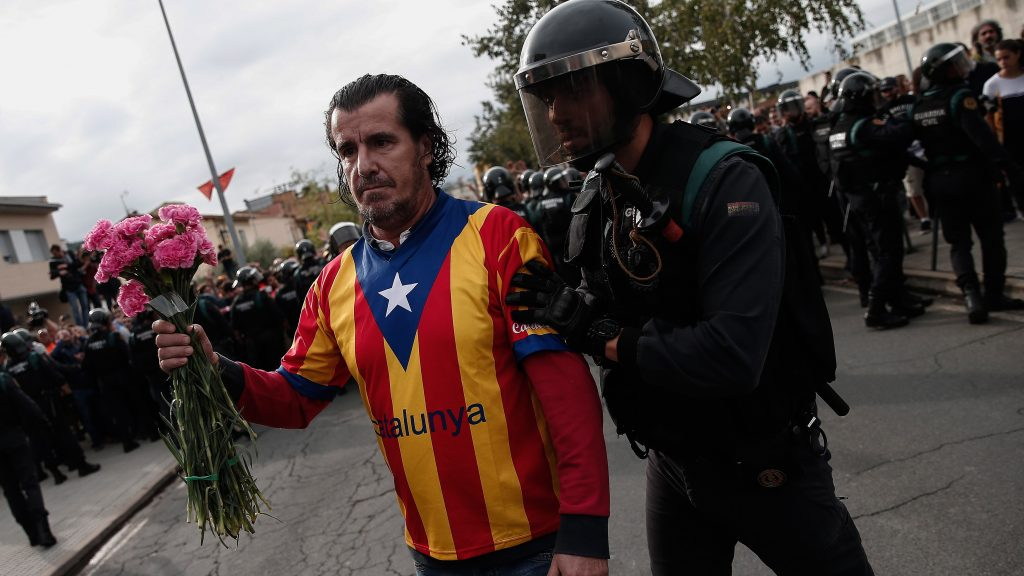 GIRONA, SPAIN - OCTOBER 1: Police and gendarmerie crew intervene the voters in the Catalan independence referendum at a sport hall, where Catalan President Carles Puigdemont would be voting, in Girona, Spain on October 1, 2017. Tensions rose in some voting centers, including Saint Julia de Ramis School in Girona and Ramon Llull School in Barcelona, as dozens of anti-riot Spanish police blocked Catalan activists from voting. Burak Akbulut / Anadolu Agency