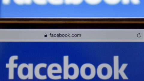 """(FILES) This file photo taken on December 28, 2016 in Vertou, western France, shows logos of US online social media and social networking service Facebook. Facebook said October 5, 2017 it was testing a new """"button"""" to allow users to get more context about a news source, in the latest move by the leading social network to curb misinformation.The new feature will allow users to get context on the source of a news article with a single click without leaving Facebook and its news feed.  / AFP PHOTO / LOIC VENANCE"""