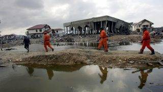 BANDA ACEH, INDONESIA - JANUARY 14: Members of Mexican and German search and rescue teams look for bodies amongst the rubble of destroyed homes January 14, 2005 in Banda Aceh, Indonesia. Citing safety concerns, the Indonesian government has severely restricted the movement of foreigners in Aceh province. The province of Aceh, one of the worst hit regions in the 9.0 earthquake and subsequent Tsunami, lost over 50,000 people.  (Photo by Spencer Platt/Getty Images)