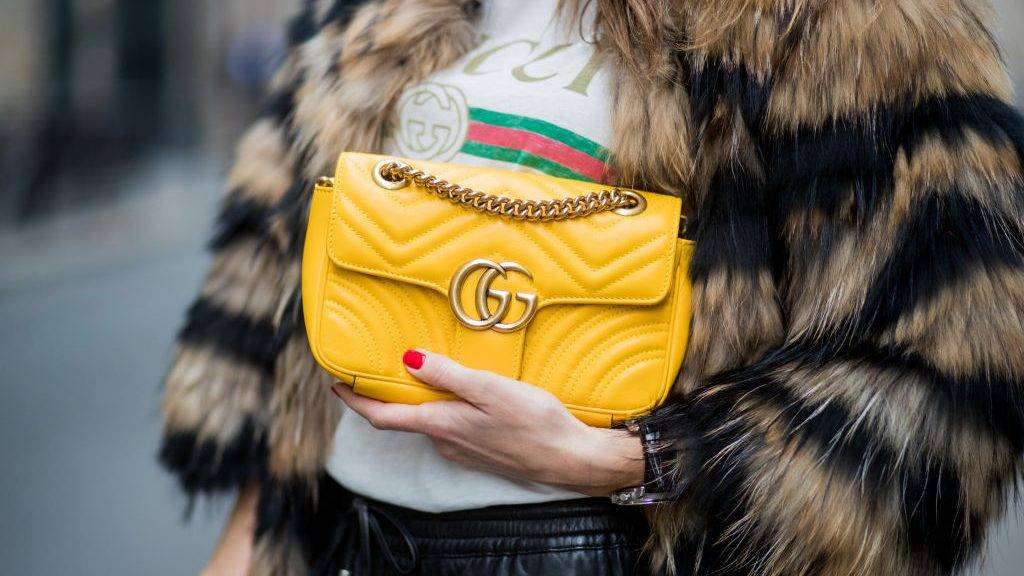 PARIS, FRANCE - SEPTEMBER 27: Alexandra Lapp wearing leather trackies in black from Set Fashion, vintage style Gucci logo tee, little fur jacket by Set, yellow GG Marmont matelasse shoulder bag by Gucci, red lacquer heels from Gianvito Rossi and Audrey sunglasses from Celine is seen during Paris Fashion Week Spring/Summer 2018 on September 27, 2017 in Paris, France. (Photo by Christian Vierig/Getty Images)