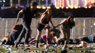 LAS VEGAS, NV - OCTOBER 01:  People run from the Route 91 Harvest country music festival after apparent gun fire was hear on October 1, 2017 in Las Vegas, Nevada. A gunman has opened fire on a music festival in Las Vegas, leaving at least 20 people dead and more than 100 injured. Police have confirmed that one suspect has been shot. The investigation is ongoing. (Photo by David Becker/Getty Images)