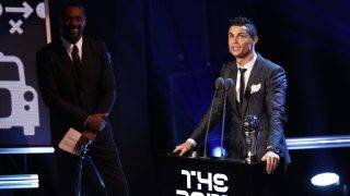 LONDON, ENGLAND - OCTOBER 23:  Cristiano Ronaldo of Portugal and Real Madrid CF wins The best Fifa men's player as Idris Elba looks on during The Best FIFA Football Awards Show on October 23, 2017 in London, England.  (Photo by Bryn Lennon/Getty Images)