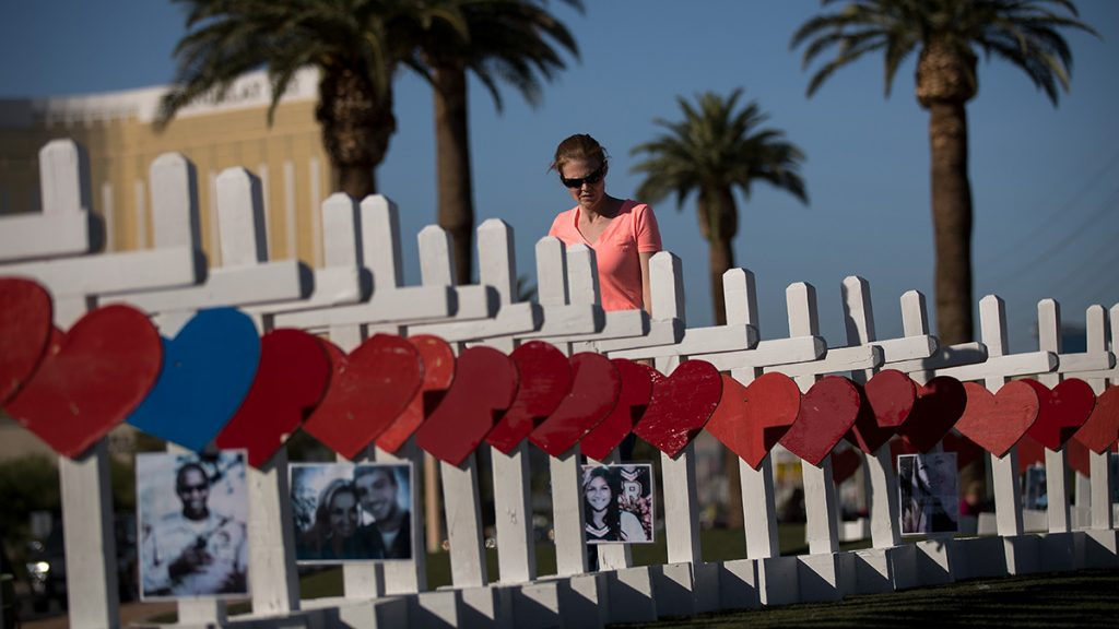 LAS VEGAS, NV - OCTOBER 5: A woman pauses while looking at some of the 58 white crosses for the victims of Sunday night's mass shooting, on the south end of the Las Vegas Strip, October 5, 2017 in Las Vegas, Nevada. On October 1, Stephen Paddock killed at least 58 people and injured more than 450 after he opened fire on a large crowd at the Route 91 Harvest country music festival. The massacre is one of the deadliest mass shooting events in U.S. history. (Photo by Drew Angerer/Getty Images)