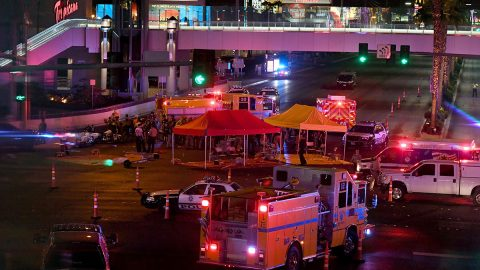 LAS VEGAS, NV - OCTOBER 02:  Police and rescue personnel gather at the intersection of Las Vegas Boulevard and Tropicana Ave. after a mass shooting at a country music festival nearby on October 2, 2017 in Las Vegas, Nevada. A gunman has opened fire on a music festival in Las Vegas, leaving at least 50 people dead and more than 200 injured. Police have confirmed that one suspect, Stephen Paddock, has been shot and killed. The investigation is ongoing. (Photo by Ethan Miller/Getty Images)