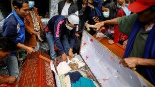 """The coffin of a deceased relative is opened by family members at Loko'mata, a traditional Toraja burial site, during an ancient Torajan ritual known as """"Ma'nene"""", near Rantepao, North Toraja, South Sulawesi, Indonesia, September 14, 2017. REUTERS/Darren Whiteside         SEARCH """"INDONESIA DEATH"""" FOR THIS STORY. SEARCH """"WIDER IMAGE"""" FOR ALL STORIES."""