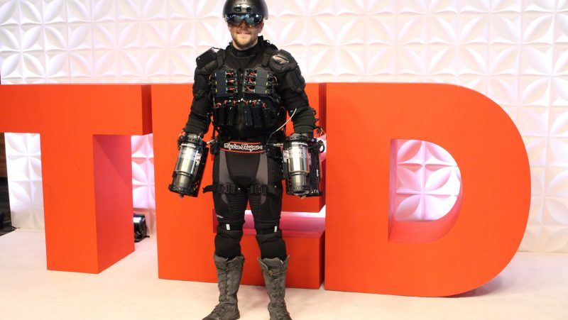 """Gravity founder Richard Browning fields questions about his personal flight suit at a TED Conference in Vancouver, Canada, on April 27, 2017. Using thrusters attached to his arms and back, Browning flew in a circle and hovered a short distance from the ground, captivating attendees of a prestigious TED Conference with the demonstration. The personal flight suit is capable of propelling wearers much higher and faster, according to its creators. / AFP PHOTO / Glenn CHAPMAN / TO GO WITH AFP STORY BY Glenn CHAPMAN """"US-Canada-Britain-lifestyle-aviation-technology-TED-Gravity"""""""""""