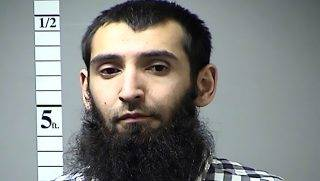 """This handout photograph obtained courtesy of the St. Charles County Dept. of Corrections in the midwestern US state of Missouri on October 31, 2017 shows Sayfullo Habibullahevic Saipov, the suspectecd driver who killed eight people in New York on October 31, 2017, mowing down cyclists and pedestrians, before striking a school bus in what officials branded a """"cowardly act of terror.""""   Eleven others were seriously injured in the broad daylight assault and first deadly terror-related attack in America's financial and entertainment capital since the September 11, 2001 Al-Qaeda hijackings brought down the Twin Towers. In April of 2016 a warrant was issued in Missouri for his failure to pay a traffic citation.   / AFP PHOTO / St. Charles County Dept. of Corrections / == RESTRICTED TO EDITORIAL USE  / MANDATORY CREDIT:  """"AFP PHOTO /  ST. CHARLES COUNTY DEPT. OF CORRECTIONS"""" / NO MARKETING / NO ADVERTISING CAMPAIGNS /  DISTRIBUTED AS A SERVICE TO CLIENTS  =="""