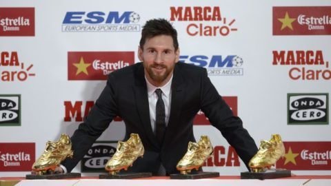 Barcelona's Argentinian forward Lionel Messi poses with his four Golden Shoe awards after receiving the 2017 European Golden Shoe honoring the year's leading goalscorer during a ceremony at the Antigua Fabrica Estrella Damm in Barcelona on November 24, 2017. / AFP PHOTO / Josep LAGO