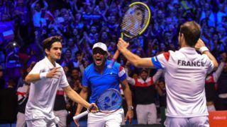 France's Pierre-Hugues Herbert (L) and Richard Gasquet (R) celebrate with their coach Yannick Noah after the doubles tennis match at the Davis Cup World Group final between France and Belgium at Pierre Mauroy Stadium in Lille on November 25, 2017.  / AFP PHOTO / PHILIPPE HUGUEN