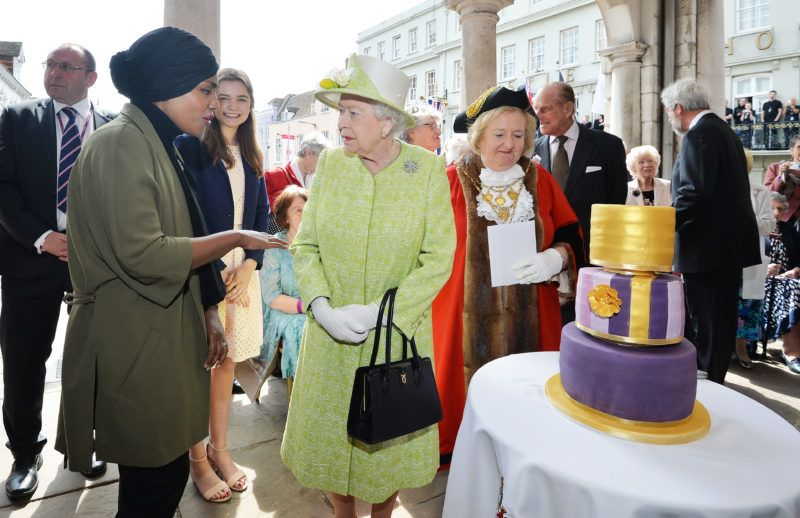 Britain's Queen Elizabeth II speaks with Nadiya Hussein (L), winner of the Great British Bake Off who baked a caker for her during a 'walkabout' on her 90th birthday in Windsor, west of London, on April 21, 2016.  Britain celebrates Queen Elizabeth II's 90th birthday on Thursday, with her eldest son Prince Charles paying tribute in a special radio broadcast and Prime Minister David Cameron leading a parliamentary homage. / AFP PHOTO / POOL / John Stillwell