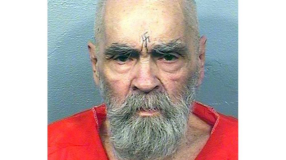 This handout photo received August 21, 2017, courtesy of California Department of Corrections and Rehabilitation shows inmate Charles Manson on August 14, 2017. Notorious US killer Charles Manson, who led a California cult that killed pregnant Hollywood star Sharon Tate, has been hospitalized in deteriorating health, entertainment news site TMZ said Wednesday, November 15, 2017. Citing an anonymous source, the site said the 83-year-old with a swastika tattoo on his forehead was rushed to Bakersfield hospital in central California three days ago and underwent a series of treatments, escorted by five policeman.  / AFP PHOTO / California Department of Corrections and Rehabilitation / Handout
