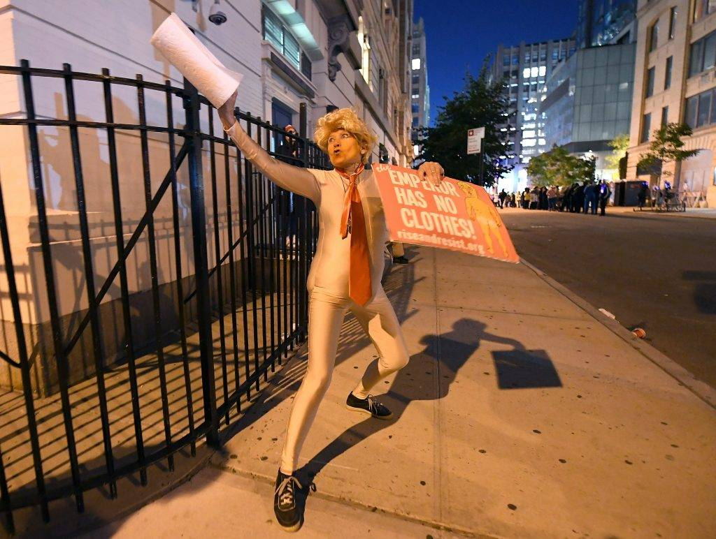 A parade participant is dressed as US President Donald Trump during the 44rd Annual Halloween Parade in New York on October 31, 2017, just hours after several people were killed and numerous others injured when a suspect plowed a vehicle into a bike and pedestrian path in Lower Manhattan. / AFP PHOTO / ANGELA WEISS