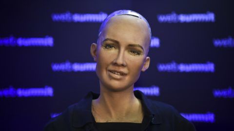 """Humanoid """"Sophia The Robot"""" of Hanson Robotics answers questions during a press conference at the 2017 Web Summit in Lisbon on November 7, 2017.  Europe's largest tech event Web Summit is held at Parque das Nacoes in Lisbon from November 6 to November 9.  / AFP PHOTO / PATRICIA DE MELO MOREIRA"""