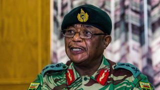 """Zimbabwe Army General Constantino Chiwenga Commander of the Zimbabwe Defence Forces addresses a media conference held at the Zimbabwean Army Headquarters on November 13, 2017 in Harare. Zimbabwe's army chief on November 13 demanded a """"stop"""" to the purge in the ruling ZANU-PF party after the sacking of vice president Emmerson Mnangangwa, and warned the military could intervene. / AFP PHOTO / Jekesai NJIKIZANA"""