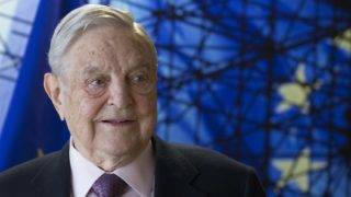 """(FILES) This file photo taken on April 27, 2017 shows George Soros, Founder and Chairman of the Open Society Foundations as he arrives for a meeting in Brussels. George Soros spoke out Monday, November 20, 2017, for the first time about Hungary's """"survey"""" on the US financier and philanthropist's views and alleged intentions on immigration, accusing Budapest of """"distortions and outright lies"""". / AFP PHOTO / POOL / OLIVIER HOSLET"""