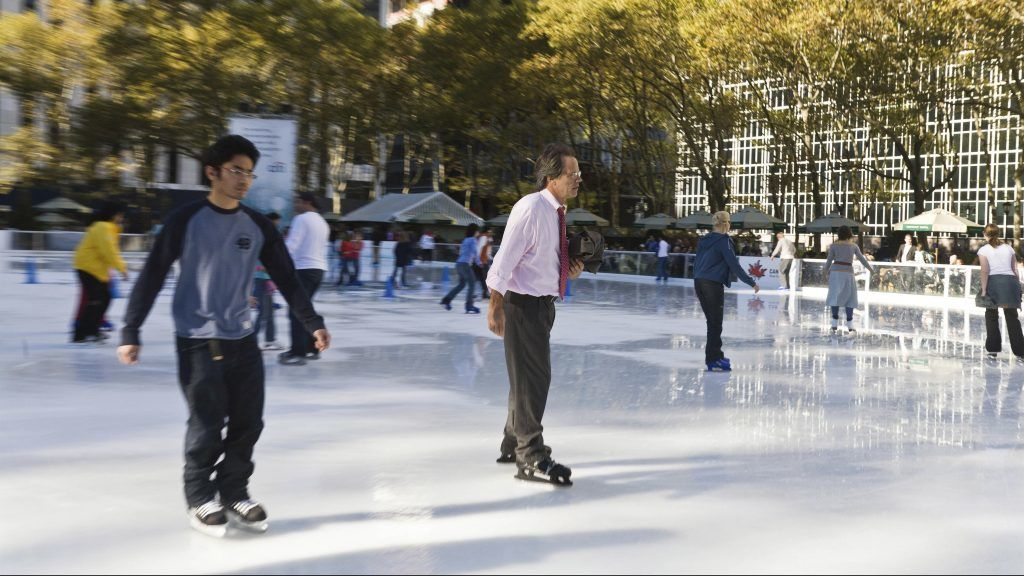 Bryant park ice skating ring and garden, New York - United states  game, suit, business man