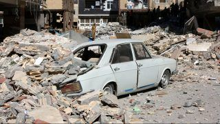 KERMANSHAH, IRAN - NOVEMBER 13: A car is trapped under the rubble in Sarpol-e Zahab town of Kermanshah, Iran on November 13, 2017 following a 7.3 magnitude earthquake that hit the Iraq and Iran. An earthquake measuring 7.3 on the Richter scale rocked northern Iraq and Iran, the U.S. Geological Survey said on Sunday evening. Turkish paramedic teams and rescue teams dispatched to the disaster area under the coordination of Turkish aid agencies; AFAD (Turkey's Disaster Management Agency) and Kizilay (Turkish Red Crescent). At least 211 died and 2,504 others were injured in Iran's bordering regions, especially in Kermanshah province in west. Fatemeh Bahrami / Anadolu Agency