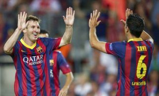 (L-R) Lionel Messi of FC Barcelona, Xavi Hernandez of FC Barcelona during the Champions League match between FC Barcelona and Ajax Amsterdam  on September 18, 2013 at the Camp Nou stadium in Barcelona, Spain(Photo by VI Images via Getty Images)