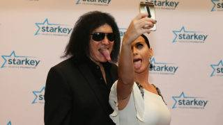 ST. PAUL, MN JULY26: Gene Simmons and Katy Perry stick their tongues out after the red carpet at the 2015 Starkey Hearing Foundation So The World May Hear Gala at the St. Paul RiverCentre on July 26, 2015 in St. Paul, Minnesota.(Photo by: Adam Bettcher/Getty Images for the Starkey Hearing Foundation)