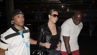 ©2009 RAMEY PHOTO June 14, 2009, Los Angeles, California Mariah Carey and her bodyguards arrive at LAX on an International flight from Munich, Germany. PR (Photo by Philip Ramey/Corbis via Getty Images)