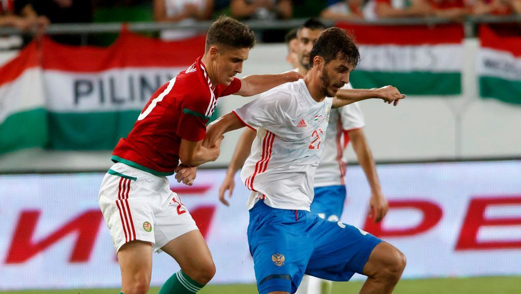 BUDAPEST, HUNGARY - JUNE 5: Aleksandr Erokhin #21 of Russia wins the ball from Roland Sallai (L) of Hungary during the International Friendly match between Hungary and Russia at Groupama Arena on June 5, 2017 in Budapest, Hungary. (Photo by Laszlo Szirtesi/Getty Images)