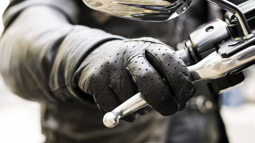 Biker's hand on brake lever handlebar