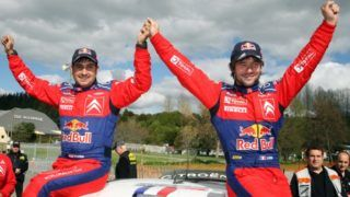 Sebastien Loeb (R) of France and co-driver Daniel Elena sit atop their Citroen C4 following their win in the World Rally Championship in Hamilton on August 31, 2008.  AFP PHOTO/Brendon O'HAGAN / AFP PHOTO / BRENDON O'HAGAN