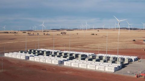"""This screen grab from an undated handout video from a drone received by AFP on December 1, 2017 from French energy firm Neoen shows the Tesla 100 MW/129 MWh Powerpack system by billionaire entrepreneur Elon Musk in the rural town of Jamestown, 200km north of Adelaide.  The world's biggest battery was officially launched in Australia on December 1, with the Elon Musk-driven project powered up early to meet peak demand amid a bout of hot weather, officials said. / AFP PHOTO / Neoen / Handout / RESTRICTED TO EDITORIAL USE - MANDATORY CREDIT """"AFP PHOTO / NEOEN"""" - NO MARKETING NO ADVERTISING CAMPAIGNS - DISTRIBUTED AS A SERVICE TO CLIENTS == NO ARCHIVE"""
