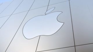 """(FILES) This file photo taken on September 22, 2017 shows an Apple logo on the outside of an Apple store in San Francisco, California.  Apple will buy leading song recognition app Shazam, the companies said on December 11, 2017, in a fresh bid by the tech giant to gain an edge in online music.""""Apple Music and Shazam are a natural fit, sharing a passion for music discovery and delivering great music experiences to our users,"""" Apple said in a statement without disclosing financial terms.  / AFP PHOTO / Josh Edelson"""